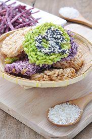 image of crispy rice  - Thai Sweet Crispy Rice Cakes with Cane Sugar Drizzle - JPG