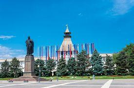 stock photo of lenin  - The monument to Vladimir Lenin in the city of Astrakhan on the background of the Astrakhan Kremlin - JPG