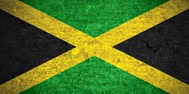stock photo of jamaican flag  - flag of Jamaica or Jamaican banner on old metal texture background - JPG