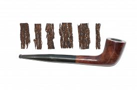 image of tobacco-pipe  - old wooden smoking pipe and pieces of pressed tobacco close - JPG