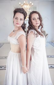 stock photo of underskirt  - Two beautiful young woman in old - JPG