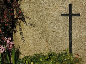 stock photo of tombstone  - Black cross engraved on granite background  - JPG