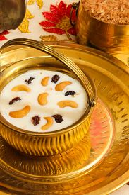 pic of pal  - Pudding Pal Payasam Kheer Indian food garnished with cashew and raisin Side View - JPG