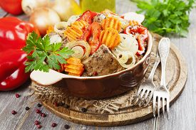stock photo of liver fry  - Liver fried with paprika carrot and onion on the table - JPG