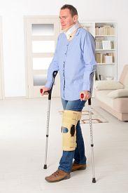 stock photo of neck brace  - Man with leg in neck brace - JPG