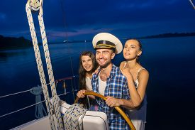 image of yacht  - Captain with girls on the yacht - JPG