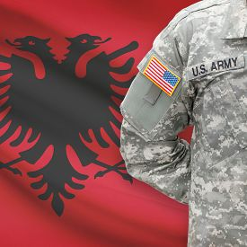 pic of albania  - American soldier with flag on background series  - JPG
