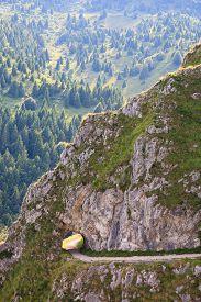 stock photo of italian alps  - Tunnel in the rock along a trekking path Italian alps - JPG