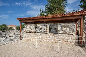 picture of medusa  - exposure with parts of architrave with a frieze with mythical giant Gorgons Medusas heads in ancient Temple of Apollo in Didim Turkey - JPG