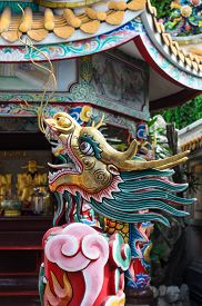 picture of roof-light  - China Dragon statue in china temple roof shot the beautiful reflected light - JPG