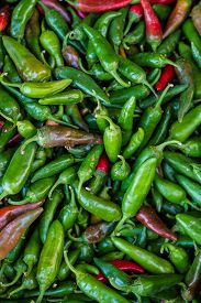 picture of red hot chilli peppers  - Heap of red and green Cayenne pepper is also called Guinea spice cow - JPG