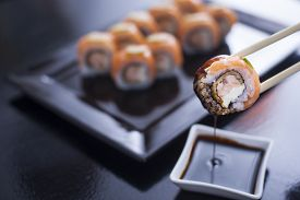 pic of soy sauce  - Sushi roll with cream cheese and fried salmon - JPG