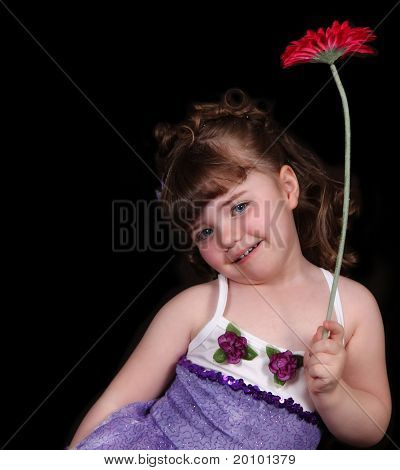Close-up Of Little Girl In Ballet Outfit Holding Flower. Isolated