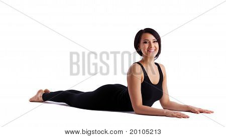 woman back bends yoga - sphinx asana smile