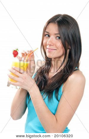 Beautiful Woman Drinking Orange Juice Cocktail With Strawberry