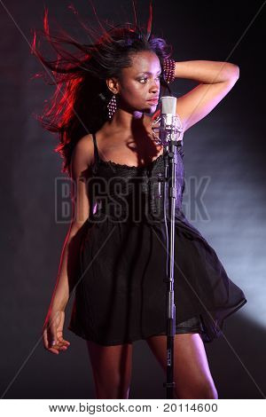 Sexy African American Girl Singing On Stage