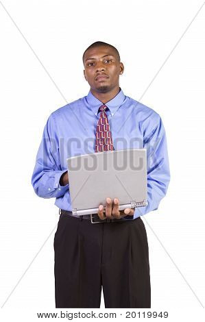 Young Black Man Standing And Working  On Laptop