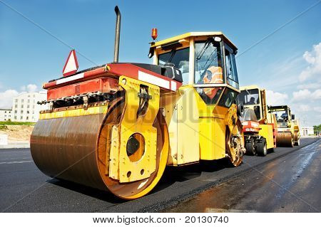 Heavy tandem Vibration roller compactor at asphalt pavement works for road repairing