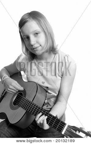 Young woman playing guitar . Portrait studio
