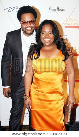 NEW YORK - MAY 3: Journalist Jawn Murray and TV host Sherri Shepherd attend the New York Gala benefiting the Steve Harvey Foundation at Cipriani's, Wall Street on May 3, 2010 in New York City.