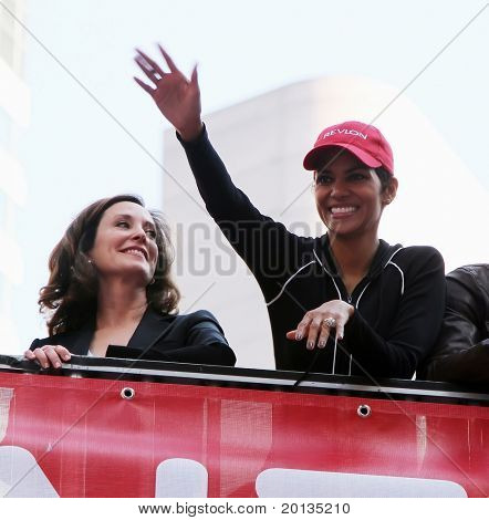 NEW YORK - MAY 1: Halle Berry (R) waves to the crowd at the 13th Annual Entertainment Industry Foundation Revlon Run/Walk for Women in Times Square on May 1, 2010 in New York City.
