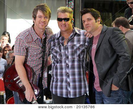 NEW YORK - JUNE 11: Guitarist Joe Don Rooney, singer Gary Levox and bassist Jay DeMarcus of Rascall Flatts perform on NBC's 'Today in Rockefeller Plaza on June 11, 2010 in New York City.