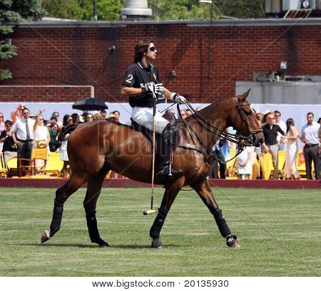 NEW YORK - MAY 30: Argentine polo player Nachos Figueras competes in the Veuve Clicquot Manhattan Polo Classic at Governors Island on May 30, 2009 in New York City.
