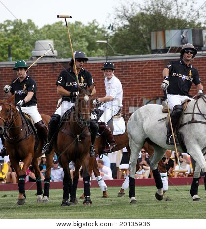 NEW YORK - MAY 30: HRH Prince Harry and Argentine player Nachos Figueras compete in the Veuve Clicquot Manhattan Polo Classic at Governors Island on May 30, 2009 in New York City.