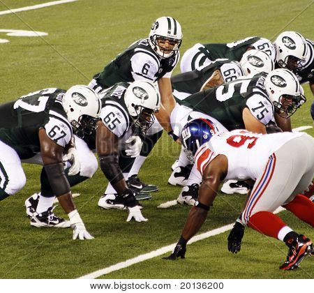 EAST RUTHERFORD, NJ - AUGUST 16: New York Jets Quarterback Mark Sanchez in action against the New York Giants at the new Meadowlands arena on August 16, 2010 in East Rutherford, New Jersey.
