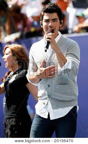 FLUSHING, NY - AUGUST 28: Singers Demi Lovato and Joe Jonas perform at Arthur Ashe Kids' Day at the Billie Jean King National Tennis Center on August 28, 2010 in Flushing, New York.
