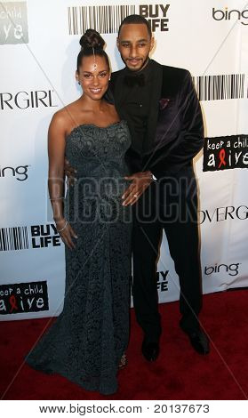 NEW YORK - SEPTEMBER 30: Singer Alicia Keys attends the Keep A Child Alive's Black Ball at the Hammerstein Ballroom with her husband, Swizz Beatz, on September 30, 2010 in New York City.