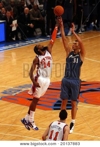 NEW  YORK - OCTOBER 17: New York Knicks center Ronny Turiaf (14) blocks a shot against  Washington Wizards forward Yi Jianlian at Madison Square Garden on October 17, 2010 in New York City.
