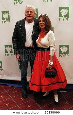 NEW YORK - OCTOBER 29: Phil Donohue and Marlo Thomas attend the 15th Annual Bette Midler's New York Restoration Project's Hulaween at the Waldorf-Astoria Hotel on October 29, 2010 in New York City.