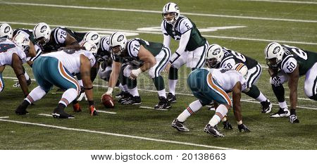 EAST RUTHERFORD - DECEMBER 12: New York Jets quarterback Mark Sanchez makes (a play in a losing effort to the Miami Dolphins (10-6) at Meadowlands Stadium on December 12, 2010 in East Rutherford, NJ.