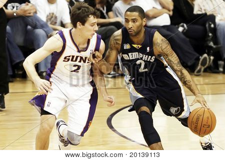PHOENIX, AZ - NOVEMBER 5: Phoenix Suns point guard Goran Dragic (2)  and Memphis Grizzlies Acie Law (2) during a game at US Airways Center on November 5, 2010 in Phoenix, Arizona.