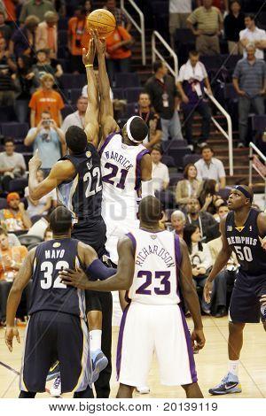 PHOENIX, AZ - NOVEMBER 5: Phoenix Suns point forward Hakim Warrick (21) and Memphis Grizzlies forward Rudy Gay (22) battle for the ball at US Airways Center on November 5, 2010 in Phoenix, Arizona.