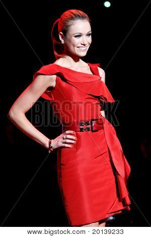 NEW YORK - FEBRUARY 9:  Katrina Bowden walks the runway at The Heart Truth's Red Dress Fashion Show during Mercedes-Benz Fashion Week at Lincoln Center on February 9, 2011 in New York City.