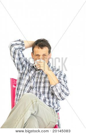image of adult man resting with coffee mug