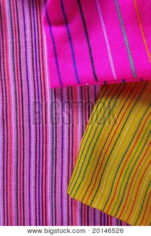 Mexican serape vibrant colorful macro fabric texture background