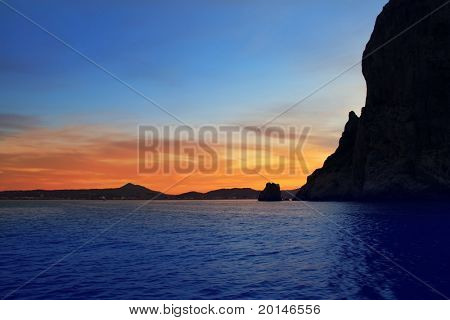 Cape San Antonio Javea Xabia sunset view from sea Mediterranean backlight Alicante Spain