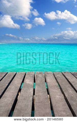 Caribbean wood pier with turquoise aqua sea blue sky Mayan Riviera