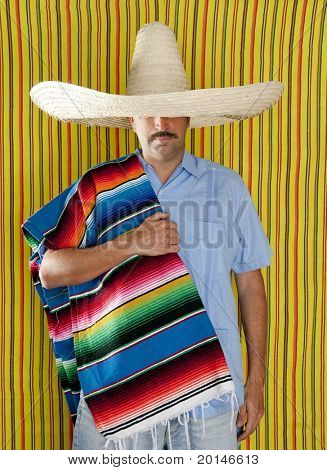 Mexican man serape poncho hat sombrero yellow stripes background