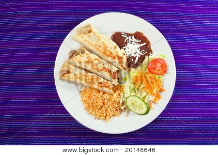 Burritos mexican rolled food rice salad and frijoles Mexico food