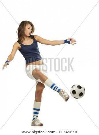 Girl Kicks soccer ball. Active lifestyle.