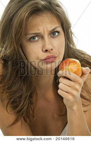 Young embarrassed woman with an apple