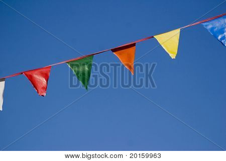 colorful flag banner on azure blue sky