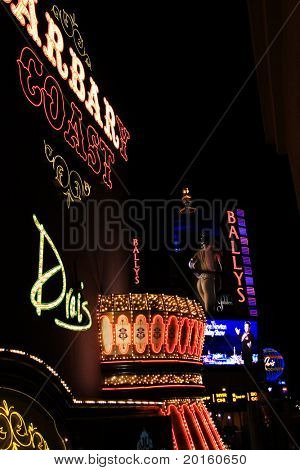 nighttime in Las Vegas showing Barbary Coast and Bally's