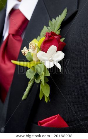 man's floral pin with red tie