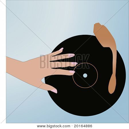 hand on record player