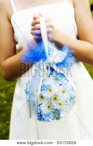 bridesmaid (or bride) with blue flower accents